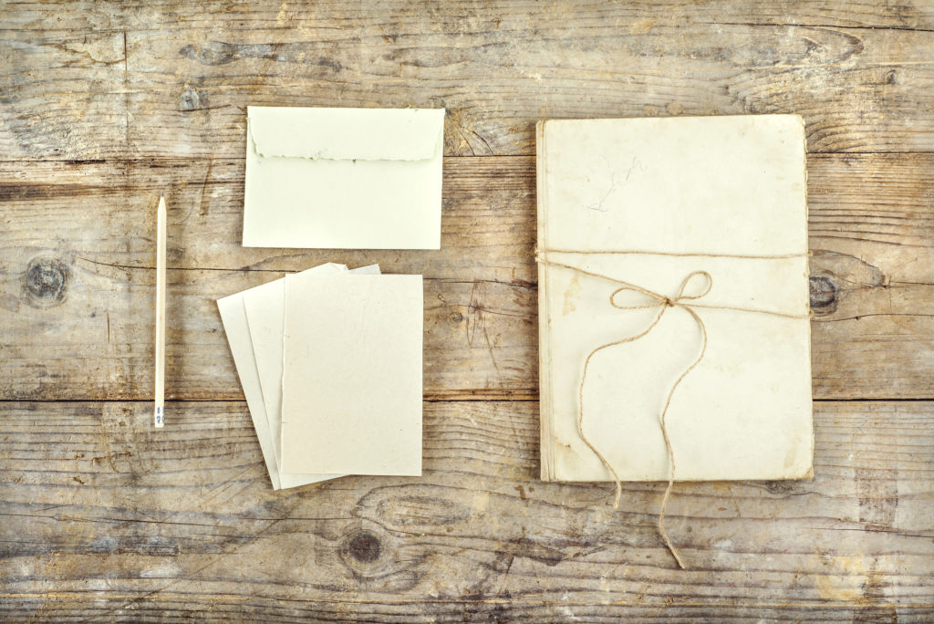 Stationery set on a wooden floor.